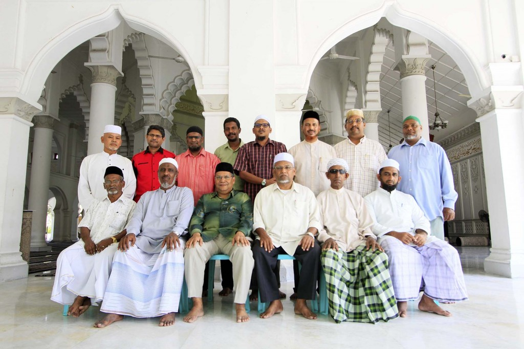 The Kapitan Keling Mosque committee.  Seated, from left: Jagaber Merican, Haji Ameer Hamza, Haji Anvar Hussain (vice chairman), Haji Meera Mydin (chairman), Ustaz Latif, Ustaz Jiyavul Hak. Standing, from left: Haji Rashid, Mohamed Meera, Kamarudin, Mohamed Rizwan, Azman, Haji Faruk, Naina, Shaik Ibrahim.